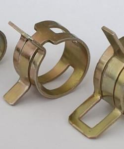 Типы хомутов для крепления труб